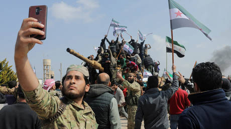 Militants backed by US and Turkey protest ceasefire in Syria's Idlib province, March 15, 2020.