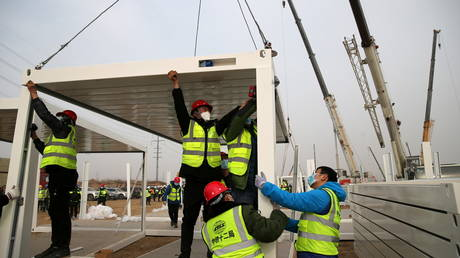 Construction workers set up a centralised quarantine site at Guying village, Hebei province, China January 14, 2021.