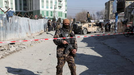 FILE PHOTO: An Afghan security officer stands guard in Kabul, Afghanistan December 15, 2020.