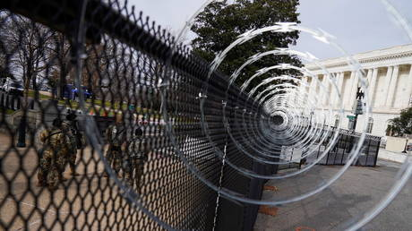 Razor wire is seen on a fence around the US Capitol as National Guard members stand guard ahead of US President-elect Joe Biden's inauguration, in Washington, US, January 17, 2021