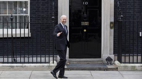 FILE PHOTO: Joe Biden arrives in Downing Street in central London