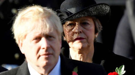 UK Prime Minister Boris Johnson and former PM Theresa May at a memorial event in London, November 2019. © Reuters / Toby Melville