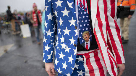 FILE PHOTO: A man wearing a patriotic suit and Donald Trump themed tie joins supporters queueing before President Donald Trump holds a rally on October 26, 2020 in Lititz, Pennsylvania