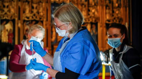 Medical staff work at a vaccination centre inside the Salisbury Cathedral, in Salisbury, Britain January 20, 2021.