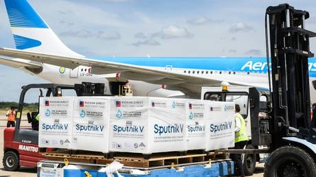 """The plane with the second batch of the Russian vaccine """"Sputnik V"""" at the airport in Buenos Aires."""