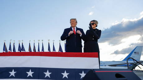 U.S. President Donald Trump arrives next to first lady Melania Trump to the Joint Base Andrews, Maryland, U.S., January 20, 2021.