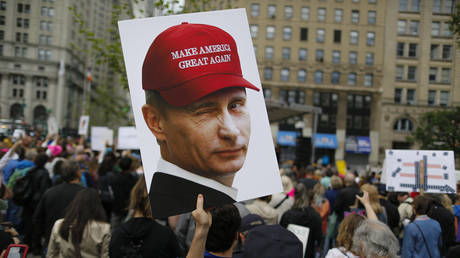 FILE PHOTO:  A demonstrator holds up a sign of Vladimir Putin during an anti-Trump rally in NYC
