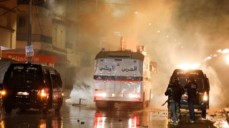 Security forces clash with demonstrators during anti-government protests in Tunis, Tunisia on January 18, 2021.
