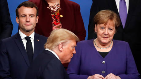 FILE PHOTO: France's President Emmanuel Macron and Germany's Chancellor Angela Merkel look at U.S. President Donald Trump during a family photo opportunity at the NATO leaders summit in Watford, Britain December 4, 2019