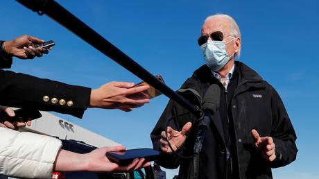 Joe Biden speaks to reporters at New Castle Airport in New Castle, Delaware, December 15, 2020 © Reuters / Mike Segar