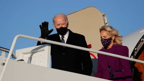 Joe Biden and his wife, Jill, are shown arriving on Tuesday at Joint Base Andrews in Maryland.