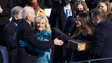 Joe Biden hugs his wife Jill after he was sworn in as the 46th President of the US at the U.S. Capitol in Washington, January 20, 2021 © Reuters / Kevin Lamarque