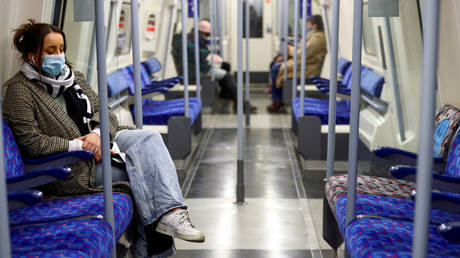 Commuters travel by underground inside an almost empty train, amid the coronavirus outbreak, in London,