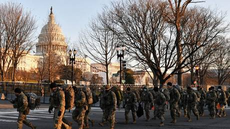 Troops prepare to exit the Capitol area after President Joe Biden's inauguration.