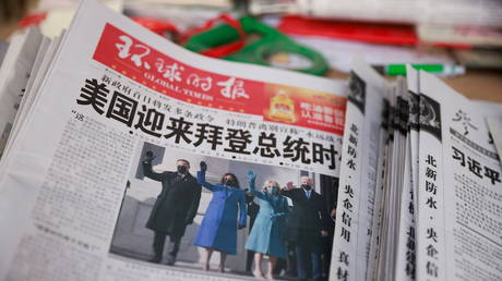 A copy of the Global Times newspaper is seen at a news stand in Beijing