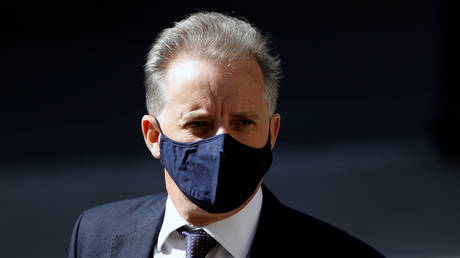 FILE PHOTO: Former British spy Christopher Steele arrives at the High Court in London, Britain, July 20, 2020