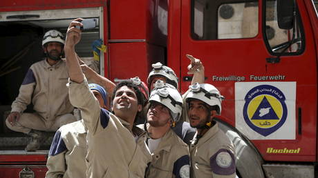 "FILE PHOTO: Members of Syria's ""White Helmets"" pose for a picture in Aleppo's al-Aryan neighborhood."