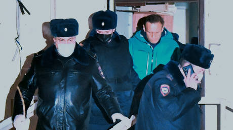 Police officers take Alexei Navalny out of the building of the 2nd police department of the Ministry of Internal Affairs of Russia in the city of Khimki, where the court held him for 30 days of arrest.