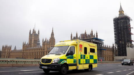 FILE PHOTO: An ambulance crosses Westminster Bridge, with the Houses of Parliament in the background, as the spread of the coronavirus disease (COVID-19) continues, in London, Britain, January 8, 2021