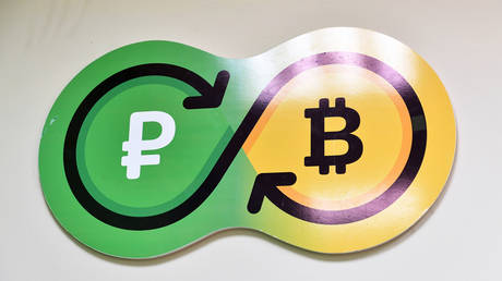 FILE PHOTO: The logo of the Sbercoin crytocurrency exchange office in Moscow © Sputnik / Vladimir Pesnya