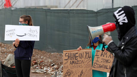 FILE PHOTO: Protesters rally outside of an Amazon warehouse