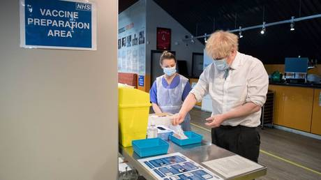 British Prime Minister Boris Johnson meets staff and patients at a coronavirus vaccination centre in north London, Britain on January 25, 2021.