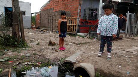 Children outside their home, during the coronavirus disease outbreak, in Laferrere, in the outskirts in Buenos Aires, Argentina