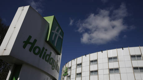 FILE PHOTO: A picture shows the boarded-off Holiday Inn hotel, close to Heathrow Airport, west of London, on March 16, 2020.