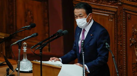 Japan's Deputy Prime Minister and Financial Minister Taro Aso delivers his policy speech at the opening of the Lower House plenary session in Tokyo, Japan January 18, 2021.