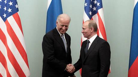 FILE PHOTO: Joe Biden and Vladimir Putin