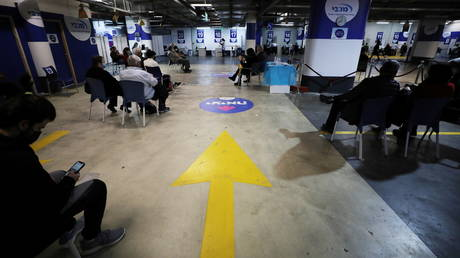 A general view picture shows people waiting to receive a vaccination against the coronavirus disease (COVID-19) at a temporary healthcare maintenance organisation (HMO) centre at an underground parking lot in Givatayim Mall, near Tel Aviv, Israel January 19, 2021