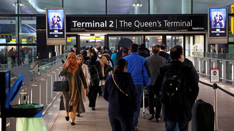FILE PHOTO: People queue to enter terminal 2, as tighter rules for international travellers start, at Heathrow Airport, amid the spread of the coronavirus disease (COVID-19) pandemic, London, Britain, January 18, 2021.