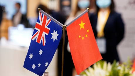 FILE PHOTO: Australian and Chinese flags are seen at the third China International Import Expo (CIIE) in Shanghai, China November 6, 2020.