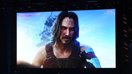 "Canadian-US actor Keanu Reeves announces the new video game ""Cyberpunk 2077"" at the Microsoft Xbox press event ahead of the E3 gaming convention in Los Angeles on June 9, 2019."