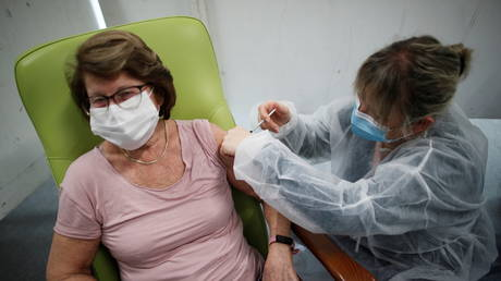 Woman receives Pfizer-BioNTech Covid-19 vaccine in Lamballe-Armor, France, January 22, 2021