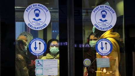 People wearing protective masks are seen in a tramway shortly before a nationwide curfew, from 6 p.m to 6 a.m, due to restrictions against the spread of the coronavirus disease (COVID-19), in Nice, France January 26, 2021.