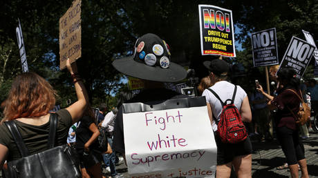 """FILE PHOTO: A protester wears a sign reading """"Fight white supremacy"""" at a protest against white nationalists in New York City, US, August 13, 2017"""