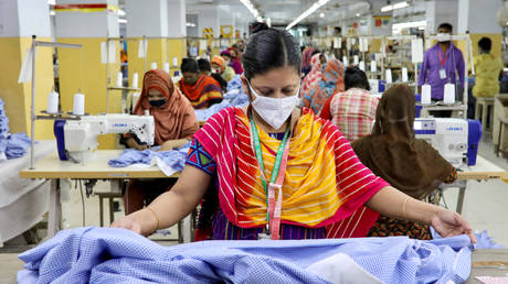 A woman works in a garment factory amid concerns over coronavirus outbreak in Dhaka