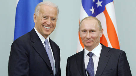 FILE PHOTO: Russian Prime Minister Vladimir Putin (R) shakes hands with US Vice President Joe Biden (L) on March 10, 2011 during their meeting in Moscow.