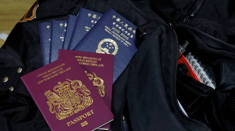 FILE PHOTO: British National Overseas passports (BNO) and Hong Kong Special Administrative Region of the People's Republic of China passports sit on top of the Lai family's baggage before they emigrate to Scotland. © REUTERS / Tyrone Siu