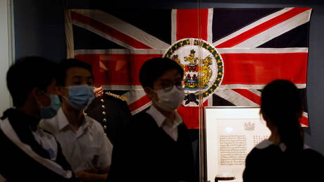 "FILE PHOTO: Secondary school students walk past the Standard of the Governor during British Hong Kong era at the exhibition ""The Hong Kong Story"" in the Hong Kong Museum of History in Hong Kong, October 16, 2020"