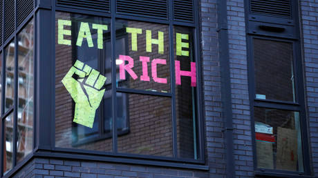"FILE PHOTO: Post-it notes reading ""Eat The Rich"" is seen on a student hall of residence building window, after new nationwide restrictions were announced during the coronavirus disease (COVID-19) outbreak in Bristol, Britain, November 3, 2020"