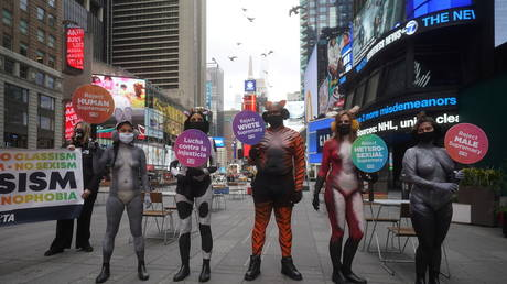 Members of PETA perform a stunt in Times Square painted as animals to protest against injustice in New York