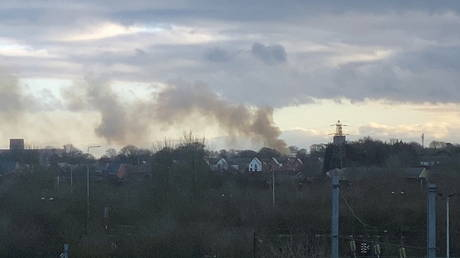 Smoke billows from a fire at Napier Barracks in Folkestone, Britain on January 29, 2021, in this still image obtained from social media video. © Andrew Tracey/via REUTERS