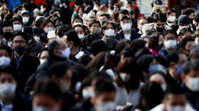 Tokyo faces state of emergency over coronavirus case surge as Japan prepares to host Olympics