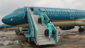 Virus-wary Vietnam suspends flights from UK and South Africa over new Covid-19 variants