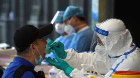WHO chief 'disappointed' China still hasn't approved entry of Covid-19 experts investigating pandemic origins