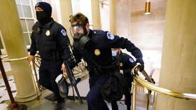 Trump supporters in ARMED STANDOFF with police inside US Capitol as offices evacuated & lawmakers told to don gas masks - reports