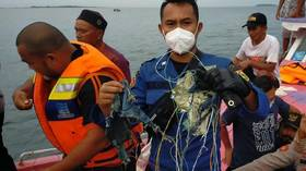 Searchers find debris during operation to locate missing Boeing jet in Indonesia (VIDEO)