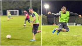 'No way that's real': Fans stunned by jet-heeled Khabib's burst of pace as UFC star plays football – but was video speeded up?